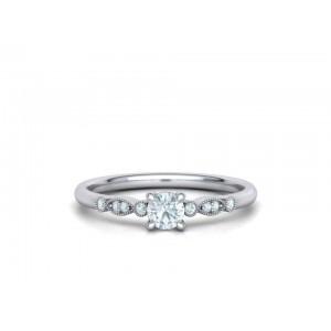 Μονόπετρο δαχτυλίδι λευκόχρυσο Κ18  vintage με διαμάντι 0.22ct και πέτρες στο πλάι