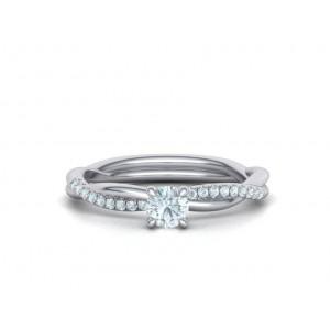 Μονόπετρο δαχτυλίδι άπειρο - πλεξούδα λευκόχρυσο Κ18 με διαμάντι μπριγιάν 0.24ct και πέτρες στο πλάι