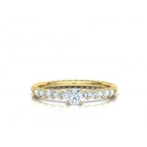 Μονόπετρο δαχτυλίδι στριφτό κίτρινος χρυσός Κ18 με διαμάντι 0.24ct και πέτρες στο πλάι 0.30ct