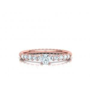 Μονόπετρο δαχτυλίδι στριφτό ροζ χρυσός Κ18 με διαμάντι 0.24ct και πέτρες στο πλάι 0.30ct